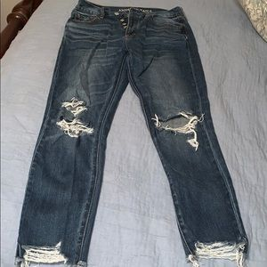 Ripped high rise girlfriend jeans